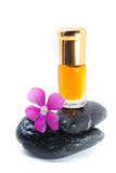 Generic Perfume and Purple Flower on stone, white background Stock Photos