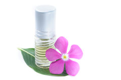 Generic Perfume and Purple Flower, white background Royalty Free Stock Image