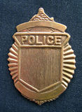 Generic Police Badge. Police badge on blue material stock photography