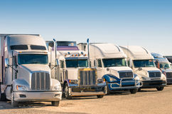 Generic semi Trucks at a parking lot. At american gas station Royalty Free Stock Photography