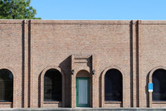 Generic small brick office exterior stock image