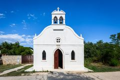 Generic small old church on Silba Island in Croatia. Small white church with bells, doors and windows on small Croatian island Silba Royalty Free Stock Image