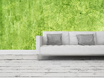 Generic sofa on a green wall with abstract pattern Royalty Free Stock Photos