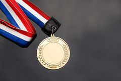 Generic sporting event gold medal with red and blue ribbon Stock Photography