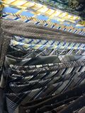 Generic ties for sale. Dress up mens ties organized on a shelf in a mens shop for Royalty Free Stock Photo