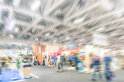 Generic trade show stand with blurred zoom defocusing. Concept of business social gathering for international meeting exchange Royalty Free Stock Photo