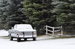 Generic Truck in the Winter. Winter country road with generic truck parked on the side in falling snow Stock Images
