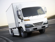 Generic white industrial transport truck traveling down the road with motion blur. Stock Photo