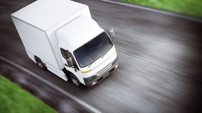 Generic white industrial transport truck traveling down the road with motion blur. Room for text or copy space. Royalty Free Stock Photography