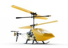 Generischer gelber ferngesteuerter Hubschrauber auf weißem Ba Lizenzfreies Stockfoto