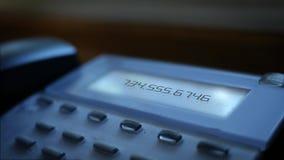 Generiskt nummer som kallar meddelandet på modernt affärslandlinesystem lager videofilmer