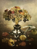 Generous gifts of of autumn. Fruits in a vase on a vintage background, grapes, apples, peach, royal apple, quince, and autumn leaves on the background Royalty Free Stock Images