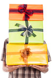 Generous man carrying gifts Royalty Free Stock Photography