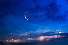 Crescent moon with beautiful sunset background. Generous Ramadan . Light from sky . Religion background stock photo