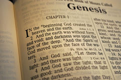 """Genesis Chapter One. First verse in the Bible; """"In the beginning God created the heaven and the earth Royalty Free Stock Photo"""