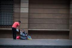 Genesosity et amour sur les rues Image libre de droits