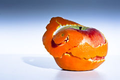 Genetic engineering. An apple revealed in the peel ov an orange Stock Images
