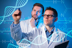 Genetic engineering. Group of geneticists working at media screen. Genetic engineering Stock Image