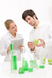 Genetic engineering - scientist in laboratory. Genetic engineering - scientists in laboratory, GMO testing experiment stock photography