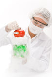 Genetic engineering - scientist in laboratory. GMO testing experiment stock photo