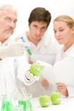 Genetic engineering - scientists in laboratory. GMO testing experiment stock images