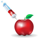 Genetic modification of fruit; apple and syringe Stock Images