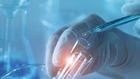 Free Genetic Research And Biotech Science Concept. Human Biology And Pharmaceutical Technology On Laboratory Background Stock Photos - 154742533