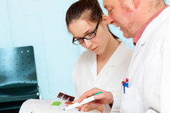 Genetic test. Council of physicians review the results of a genetic test stock photos