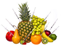 Genetically доработанные плодоовощи изолированные на белизне. Концепция GMO. стоковое фото rf