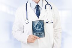 Geneticist. Doctor holding modern medical tablet with genetic analysis Royalty Free Stock Photo