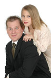 Genetics. Young girl leaning on her fathers shoulder as he kneels down on the floor. This is an image from a father taking his daughter to the annual father and royalty free stock images