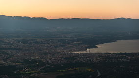 Geneva aerial day to night time lapse stock footage