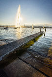 The Geneva city. The famous Water Fountain ( Jet dEau ) in Geneva with a beautiful sunset in the background. Photo taken on: Juillet 03rd, 2015 royalty free stock photos