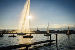 The Geneva city. The famous Water Fountain ( Jet dEau ) in Geneva with a beautiful sunset in the background. Photo taken on: Juillet 03rd, 2015 royalty free stock images
