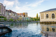 Geneva city at sunset, Switzerland. BFM, apartment buildings and Rhone river at sunset in central Geneva, Switzerland - HDR Royalty Free Stock Image