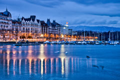 Geneva Cityscape. Geneva Switzerland old buildings at Lake Geneva Shores at dawn with marina Royalty Free Stock Photography