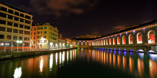Geneva Cityscape At Night. Geneva Cultural Centre building is on the rightside and River Rhone flows silently following its course Royalty Free Stock Image
