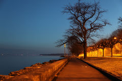 Geneva Dawn. A lakeside pathway by Lake geneva Stock Photography