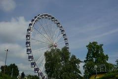 Geneva Ferris wheel on lake shoreline. Amusement in park Anglais on lake Geneva shoreline royalty free stock images