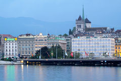 Geneva, finance and luxury city. GENEVA, SWITZERLAND – MAY 24: Old town cathedral and waterfront luxury brand offices in Geneva, Switzerland on May 24, 2008 Royalty Free Stock Images