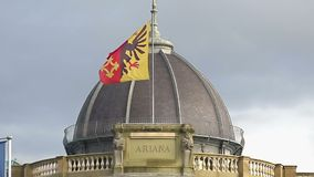 Geneva flag on Musee Ariana roof, Swiss Museum of Ceramics and Glass, slow-mo. Stock footage stock video footage