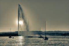 Geneva fountain. The Geneva fountain and the Lake Geneva, backlight, split toned royalty free stock photo