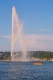 Geneva Fountain, rainbow and boat Royalty Free Stock Image