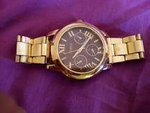 Geneva golden wrist watch  fabulous Royalty Free Stock Images