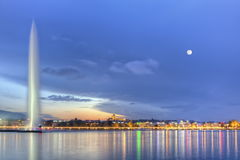 Geneva lake with famous fountain, Switzerland, HDR. Geneva lake with famous fountain by night with full moon, Switzerland, HDR royalty free stock photography