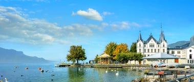 Geneva Lake in Vevey. Vaud canton, Switzerland. Panoramic view of Geneva Lake and embankment with quay in Vevey. Vaud canton, Switzerland royalty free stock photography