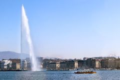 Geneva lakefront Water jet cityscape cruise ship buildings stock image