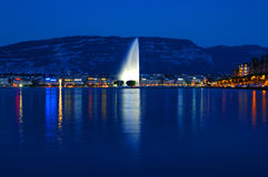 Geneva by Night. Geneva lake front at night with the a beautiful light on the Jet d'Eau in the center Stock Photos