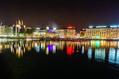 Geneva at night, Switzerland. Geneve at night seen from the Pont (Bridge) des Bergues towards the island on the Rohne rives as it flows out of Lake Geneva Stock Images