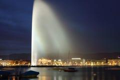 Geneva by night. Geneva water jet (le jet deau), night view in Leman Lake (Switzerland). Photo taken on: April 03rd, 2014 stock photo